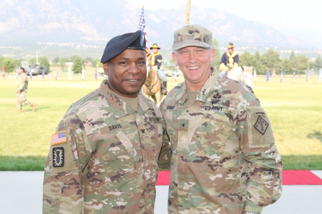 Col. Frank Davis II, 71st Ordnance Group (EOD) commander, stands with Brig. Gen. James Bonner, commander of the 20th Chemical, Biological, Radiological, Nuclear, Explosives (CBRNE) Command, during a dual-purposed ceremony Sept. 6, 2017 at Founders Field on Fort Carson, Colo. The first part of the ceremony was to officially uncase the unit's colors. Uncasing the colors signifies that the unit has fully reintegrated back into its home station after a nine-month deployment to Kuwait in support of Task Force Atlas. The second part of the ceremony was a change of responsibility to recognize Command Sgt. Maj. Weston West as the new command sergeant major of 71st OD GP. West replaced Command Sgt. Maj. Brant Shyrigh, who served with Davis throughout the unit's deployment.