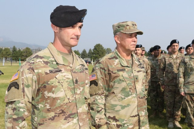 Command Sgt. Maj. Brant Shyrigh, outgoing command sergeant major of the 71st Ordnance Group (EOD), stands with Brig. Gen. James Bonner, commander of the 20th Chemical, Biological, Radiological, Nuclear, Explosives Command, during a dual-purposed ceremony Sept. 6, 2017 at Founders Field on Fort Carson, Colo. The first part of the ceremony was to officially uncase the unit's colors. The second part of the ceremony was a change of responsibility to recognize Command Sgt. Maj. Weston West as the new command sergeant major of 71st OD GP.