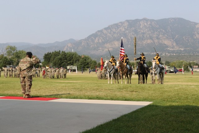 Col. Frank Davis II, 71st Ordnance Group (EOD) commander, renders a salute during a dual-purposed ceremony Sept. 6, 2017 at Founders Field on Fort Carson, Colo. The first part of the ceremony was to officially uncase the unit's colors. Uncasing the colors signifies that the unit has fully reintegrated back into its home station after a nine-month deployment to Kuwait in support of Task Force Atlas. The second part of the ceremony was a change of responsibility to recognize Command Sgt. Maj. Weston West as the new command sergeant major of 71st OD GP. West replaced Command Sgt. Maj. Brant Shyrigh, who served with Davis throughout the unit's deployment.