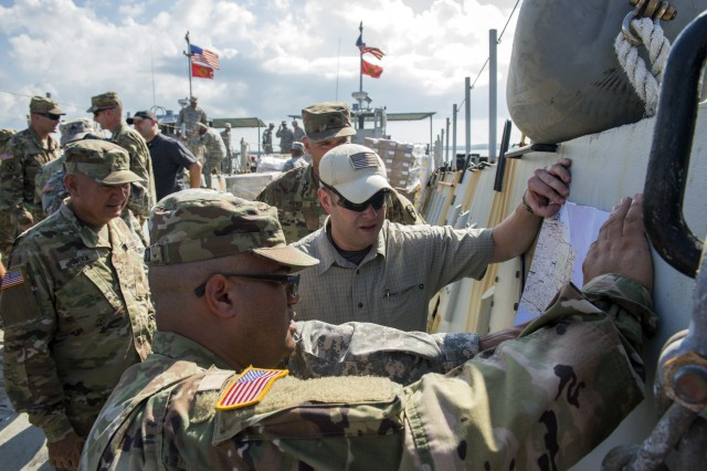 Acting Secretary of the Army Ryan McCarthy (right) checks a map of Puerto Rico as he assesses hurricane damage there and discusses recovery operations with Army leaders Oct. 19, 2017.