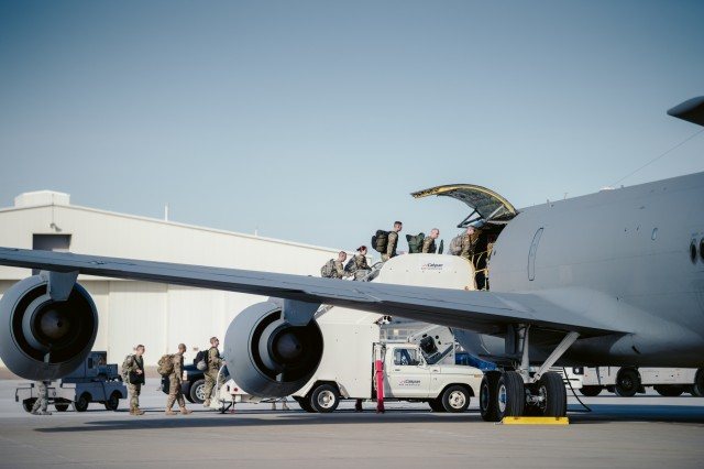 Members of the 152nd Engineer Support Company, New York Army National Guard, board a KC-135 Stratotanker from the 157th Air Refueling Wing, Pease Air National Guard Base, New Hampshire Air National Guard, to Puerto Rico, Niagara Falls Air Reserve Station, N.Y., Oct. 19, 2017. 125 members of the 152nd ESC are deploying to Puerto Rico with heavy equipment to work on such things as debris removal and restore lines of communication to bring aid in the on going hurricane relief.