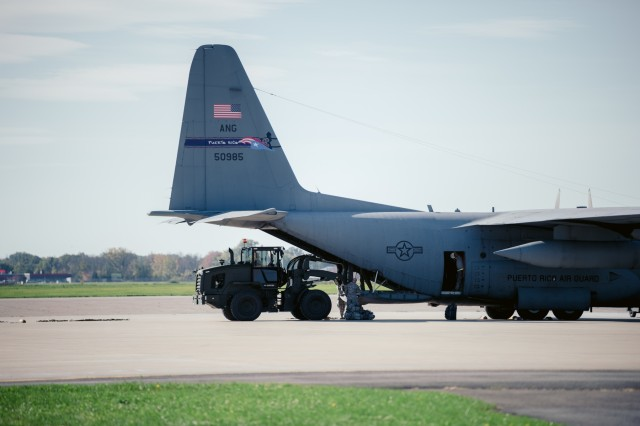 Cargo is loaded onto a WC-130 from the 156th Airlift Wing, Muñiz Air National Guard Base, Puerto Rico, to be  delivered to Puerto Rico, Niagara Falls Air Reserve Station, N.Y., Oct. 19, 2017. The cargo is going with 125 members of the 152nd Engineer Support Company, New York Army National Guard, to work on such things as debris removal and restore lines of communication to bring aid in the on going hurricane relief.