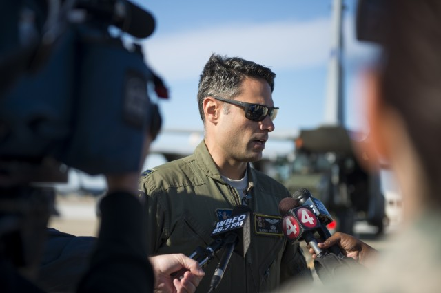 Capt. Mario Ibarra, a C-130 pilot from Muniz Air National Guard Base, Puerto Rico, speaks with local media after arriving at Niagara Falls Air Reserve Station, N.Y., October 19, 2017. He will be flying back to Puerto Rico with Soldiers from the 152nd Engineering Support Company out of Buffalo, N.Y. The Soldiers will be aiding in hurricane relief efforts. Reserve Citizen Airmen components of the 914th Logistics Readiness and 30th Aerial Port Squadrons as well as the base contractor came together to facilitate the transport and loading of cargo and personnel for the New York Army National Guard.