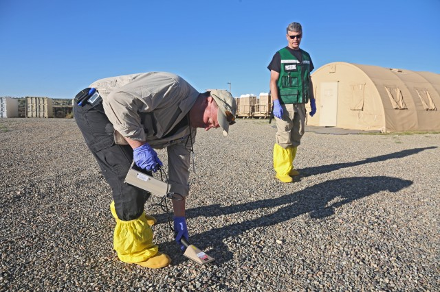 Darril Stafford with Department of Energy with conducts radiation checks using a Ludlm Radiation Detector on Onate Army National Guard Complex, New Mexico, Sept. 18, 2017. The Prominent Hunt exercise brings in federal, state, and local agencies to validate 20th Chemical, Biological, Nuclear, Explosives (CBRNE) Command as part of the National Nuclear Technical Forensic Ground Collection Task Force (NNTF GCTF).