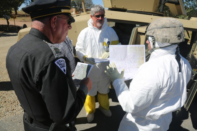 U.S. Soldiers assigned to the 20th Chemical, Biological, Nuclear, Explosives (CBRNE) Command, brief their convoy brief to the New Mexico State Police Department at Santa Fe, New Mexico, Sept. 19, 2017. The Prominent Hunt exercise brings in federal, state, and local agencies to validate 20th CBRNE Command as part of the National Nuclear Technical Forensic Ground Collection Task Force (NNTF GCTF).
