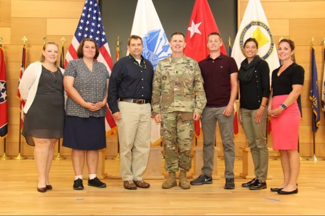 The 2017 CBRNE (Chemical, Biological, Radiological, Nuclear and Explosives) Analytical and Remediation Activity Laboratory team is congratulated by the 20th CBRNE Command's command sergeant major, Command Sgt. Major Kenneth Graham, for graduating the 2nd annual Team APG Greening Course. (From left to right) chemists Theresa Pennington and Valerie Lesniak, CARA; Director Chris Chesney, CARA; Command Sgt. Maj. Kenneth Graham; chemist Kevin Wioland, microbiologist Rebecca Lewandowski, CARA; and Natalie Polk, program support assistant, CARA. The U.S. Army Training and Doctrine Command is promoting this Army civilian program to better integrate civilian employees into the military.