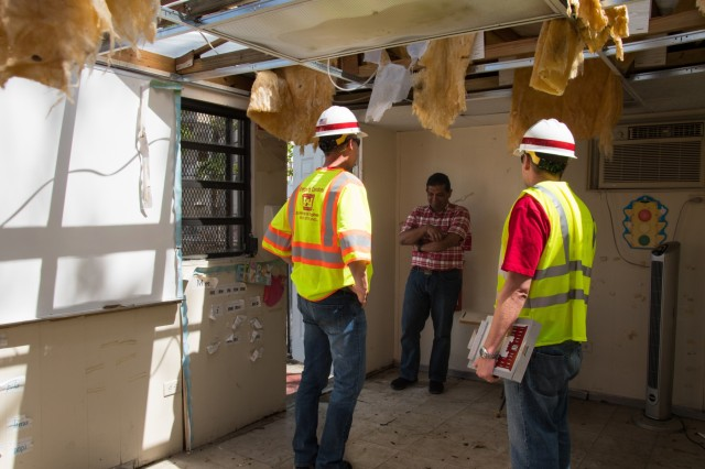 U.S. Army Corps of Engineers, Structural Engineers, Christopher R. Bamberg and Ariel A. Marrero Irizarry, speak with Elementary School Principal, Eduardo Hernandez who lost a special needs classroom to Hurricane Maria. The Corps along with their counterparts have assessed more than 250 schools between San Juan and Mayaguez, Puerto Rico on October 20, 2017.