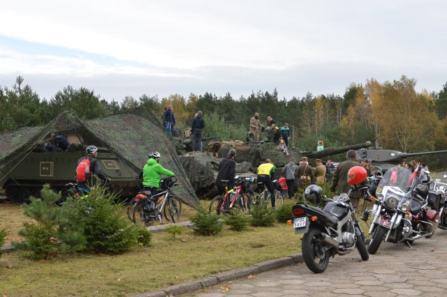 ZAGAN, Poland - U.S. Army Soldiers from 2nd Armored Brigade Combat Team, 1st Division, participate in a display of Army equipment for the Museum of Prisoner of War Camps, Zagan, Poland, Oct. 21. The museum invites the unit to support Polish-American relations, history and education regarding the Stalag Luft III Prisoner Camp and World War II, since the unit was active in Europe during that time. The museum also invites members of the Historical Association Big Red One Poland to participate in educating the public. Equipment displayed in the event are a M113 Armored Personnel Carrier M1 Abrams tank, M2 Bradley Fighting Vehicle, a Polish Medium Tank T-34/85 and a Polish BA-64 with detachable 45 mm anti-tank gun model 1937. The 2nd Armored Brigade Combat Team, 1st Infantry Division, is currently in Europe to support Atlantic Resolve. Atlantic Resolve is a U.S. endeavor to fulfill NATO commitments by rotating U.S. -based units throughout the European theater and training with NATO Allies and partners. (U.S. Army photo by Sgt. Shiloh Capers)