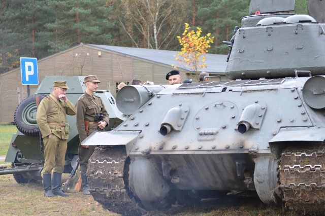ZAGAN, Poland - Volunteers and historical reenactors from the Historical Association Big Red One Poland and U.S. Army Soldiers from 2nd Armored Brigade Combat Team, 1st Division, participate in a display of Army equipment for the Museum of Prisoner of War Camps, Zagan, Poland, Oct. 21. The museum invites the unit to support Polish-American relations, history and education regarding the Stalag Luft III Prisoner Camp and World War II, since the unit was active in Europe during that time. Equipment displayed in the event are a M113, Armored Personnel Carrier M1 Abrams tank, M2 Bradley Fighting Vehicle, a Polish Medium Tank T-34/85 and a Polish BA-64 with detachable 45 mm anti-tank gun model 1937. The 2nd Armored Brigade Combat Team, 1st Infantry Division, is currently in Europe to support Atlantic Resolve. Atlantic Resolve is a U.S. endeavor to fulfill NATO commitments by rotating U.S. -based units throughout the European theater and training with NATO Allies and partners. (U.S. Army photo by Sgt. Shiloh Capers)