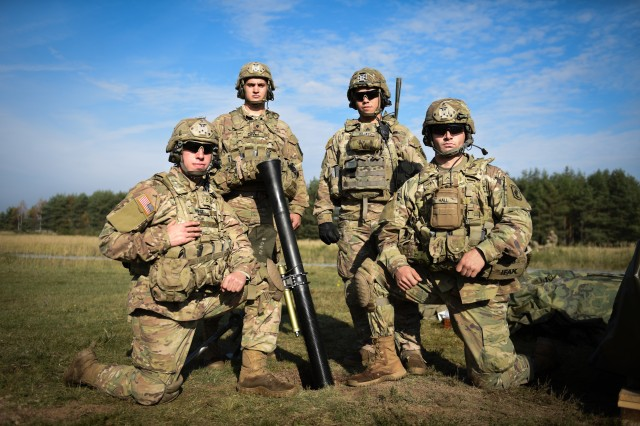 U.S. Army paratroopers Pfc. James West, Spc. Markus Carver, Sgt. Rodolfo Rojas, and Pvt. William Hall, mortar team members assigned to Headquarters and Headquarters Company, 2nd Battalion, 503rd Infantry Regiment (Airborne), 173rd Airborne Brigade pose with the M252A1 81mm Mortar System during a live fire range on October 20th, 2017. The 173rd Airborne Brigade is the U.S. Army's Contingency Response Force in Europe, providing rapidly deploying forces to the U.S. Army Europe, Africa and Central Command Areas' of Responsibility within 18 hours.