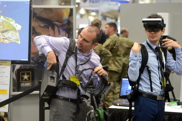Attendees at the Association of the U.S. Army's Annual Meeting and Exposition, Oct. 11, 2017 use augmented reality devices developed by Dismounted Soldier Training Technologies, U.S. Army Research Laboratory and industry partner Chosen Realities LLC.