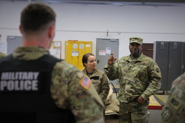 Spc. Lucius King, right, a 7th Mission Support Commnand Soldier, asks a question of Sgt. Turner Andrews, a military police officer from the 561st Military Police Company, during drunk driver awareness safety training Sunday, Oct. 22, 2017 at the 7th MSC's motor pool on Daenner Kaserne in Kaiserslautern, Germany. (U.S. Army Reserve photo by Sgt. Daniel J. Friedberg)