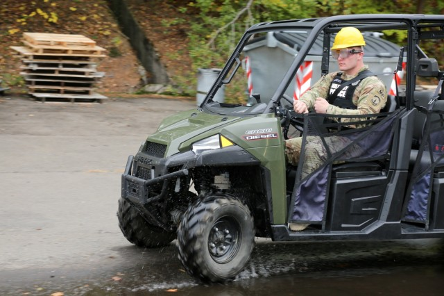 Sgt. Ian Capps, a military police officer from the 561st Military Police Company, tries to drive a Gator utility vehicle with goggles simulating two times over the United States' legal alcohol driving limit during drunk driver awareness safety training Sunday, Oct. 22, 2017 at the 7th MSC's motor pool on Daenner Kaserne in Kaiserslautern, Germany. (U.S. Army Reserve photo by Sgt. Daniel J. Friedberg)