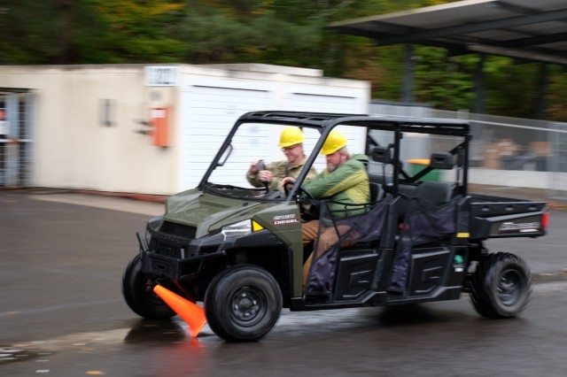 Sgt. 1st Class John Freese and Stephen Graves crash into a traffic cone during drunk driver awareness safety training Sunday, Oct. 22, 2017 at the 7th 7th Mission Support's motor pool on Daenner Kaserne in Kaiserslautern, Germany. (U.S. Army Reserve photo by Sgt. Daniel J. Friedberg)