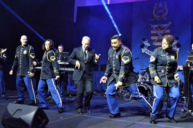 "The U.S. Army Band ""Pershing's Own,"" Downrange share the stage with 2017 Marshall Medal recipient actor Gary Sinise Oct. 11 in Washington, D.C."