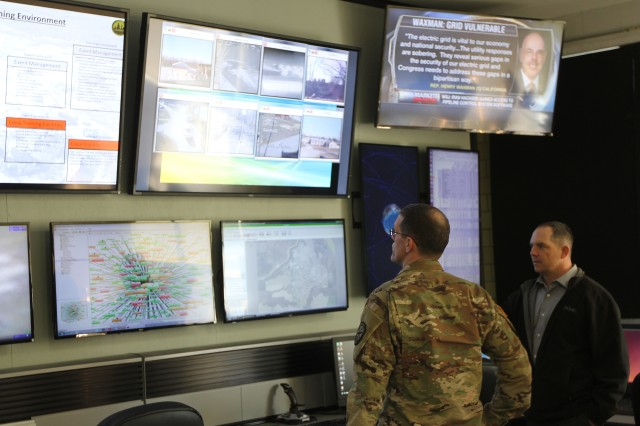 Daniel Yeager, a cyber support technician for the Muscatatuck Urban Training Center, briefs Col. John Branch, commander of the 780th Military Intelligence Brigade (Cyber), on the capabilities of the Cyber Operations Center, in support of tactical and cyber operations at MUTC, Butlerville, Indiana, March 15, 2017.