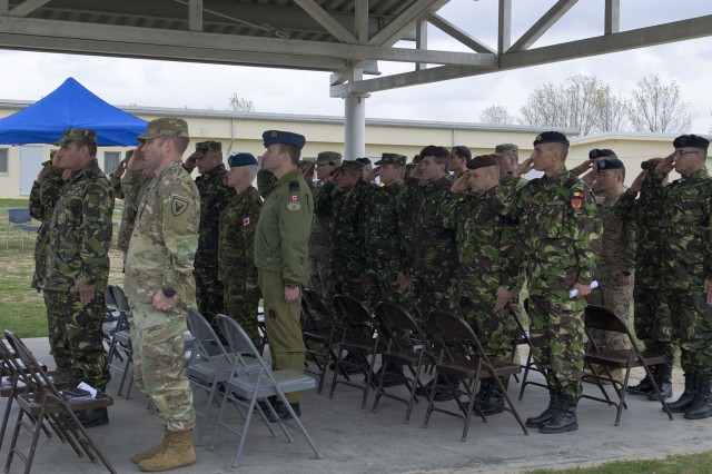 "The distinguished visitors render salutes during the Romanian and the Unite States national anthems during the1st Battalion ""Vanguard,"" 18th Infantry Regiment, 2nd Armored Brigade Combat Team, 1st Infantry Division, arrival ceremony at the Mihail Kogalniceanu Air Base parade field Oct. 23, 2017. In support the Atlantic Resolve, the 2nd ABCT brought more than 250 soldiers and various equipment to Poland and Romania to demonstrate the United States commitment to sustain collective combat readiness, while conducting bilateral training with their Romanian counterparts to enhance their interoperability as a combined force. (U.S. Army photo by Sgt. Justin Geiger)"