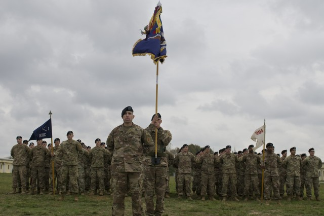 "Soldiers with the 1st Battalion ""Vanguard,"" 18th Infantry Regiment, 2nd Armored Brigade Combat Team, 1st Infantry Division, stand in formation during their arrival ceremony at the Mihail Kogalniceanu Air Base parade field Oct. 23, 2017. In support the Atlantic Resolve, the 2nd ABCT brought more than 250 soldiers and various equipment to Poland and Romania to demonstrate the United States commitment to sustain collective combat readiness, while conducting bilateral training with their Romanian counterparts to enhance their interoperability as a combined force. (U.S. Army photo by Sgt. Justin Geiger)"