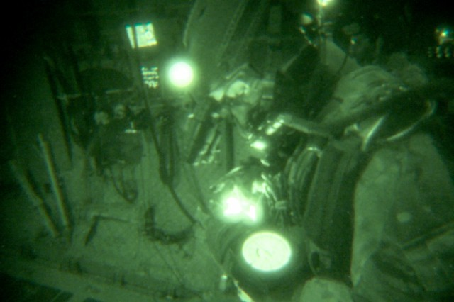 A Special Forces military free fall Soldier with the Parachute Navigation System (PARANAVSYS), executes a night operation.
