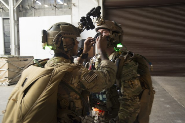 A Special Forces military free fall Jumpmaster conducts a pre-jump inspection during Parachute Navigation System (PARANAVSYS) operational testing.