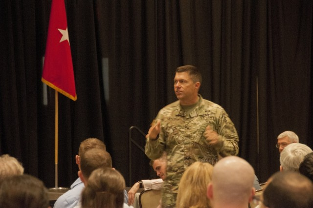 Brig. Gen. Mark Landes, deputy commanding general-support, 1st Armored Division and Fort Bliss, discusses the impact of medical readiness for units at Fort Bliss during William Beaumont Army Medical Center's Annual Medical Staff Training Day, Oct. 6. During the conference, WBAMC healthcare professionals discussed the importance of medical readiness, creating positive patient experiences and other healthcare-specific topics.