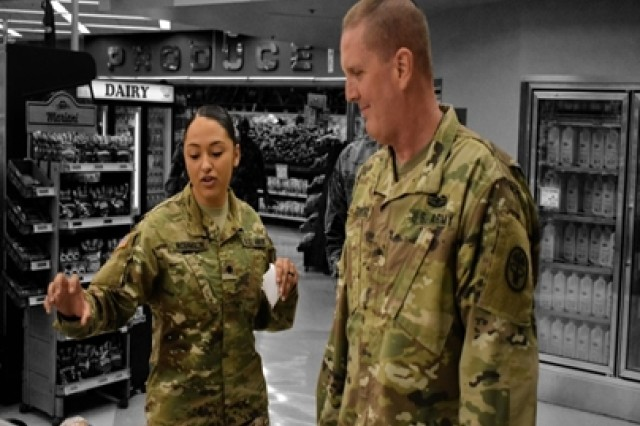 Brig. Gen. Erik H. Torring, (right), chief, Army Veterinary Corps, and Veterinary Food Inspection Specialist, Spc. Jayde Robinson, discuss the Defense Commissary Agency and commissary operations.