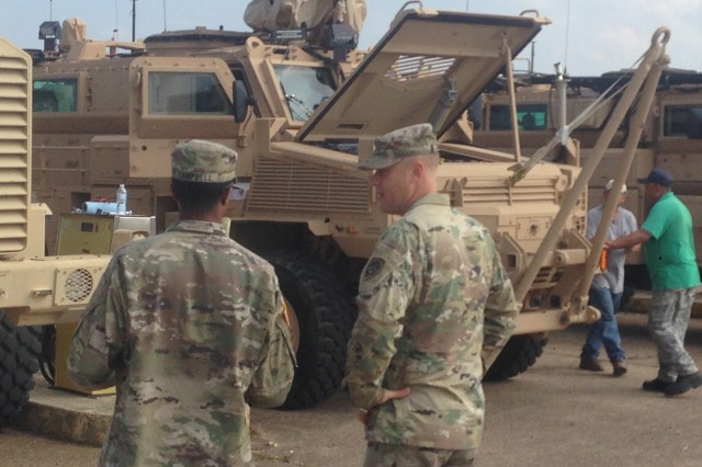 Sgt. 1st Class Charles Campbell (left), 3rd Platoon Sergeant with the 509th Engineer Company, 5th Engineer Battalion, 36th Engineer Brigade, discusses the Medium Mine Protected Vehicle (MMPV) Type II maintenance plan with Sgt. 1st Class Nicholas Barnum, A test NCO with the U.S. Army Operational Test Command.