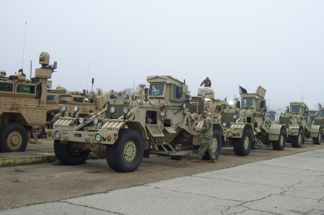 Husky vehicles are staged in preparation for Operational Testing. The Husky is the lead vehicle in route clearing operations.