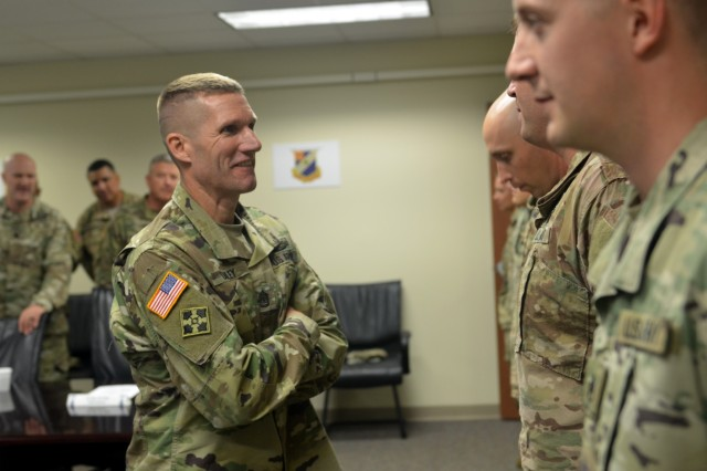 Sgt. Maj. of the Army Daniel A. Dailey presents Soldiers of the 1st Security Force Assistance Brigade with coins during a visit to Fort Benning, Ga., Oct. 16, 2017. Dailey said the SFAB is the number one priority of the Army's Chief of Staff, Gen. Mark A. Milley. (U.S. Army photo by Staff Sgt. Sierra A. Melendez, 50th Public Affairs Detachment, 3rd Infantry Division public affairs)