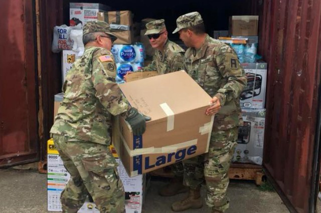 Soldiers with the 120th Infantry Brigade, First Army Division West, load boxes of hurricane relief supplies to be shipped to Puerto Rico Oct. 17, 2017, at Fort Hood, Texas. Approximately 30 Soldiers in the brigade gathered and sent 13 tons of food, water, generators and other aid supplies to the island.