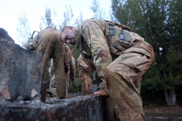 Soldiers with the 25th Infantry Division in Hawaii tackle obstacles in February 2017, while evaluating a new, lighter-weight uniform.
