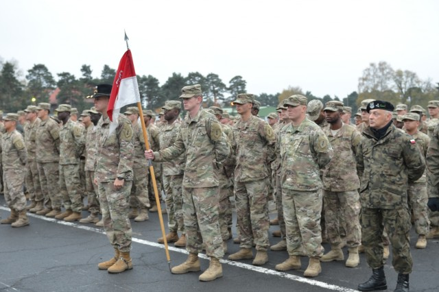 Delta Troop, 5th Squadron, 4th Cavalry Regiment, 2nd Armored Brigade Combat Team, 1st Infantry Division, participated in a ceremony with Polish soldiers from the 10th Armored Cavalry Brigade, 11th Lubuska Armored Cavalry Division, to celebrate the partnership between the U.S. and Poland at Red Square in Swietoszow, Poland, Oct. 23. The 5th Squadron, 4th Cavalry Regiment, 2nd Armored Brigade Combat Team, is in Europe to support Atlantic Resolve. Atlantic Resolve is a U.S. endeavor to fulfill NATO commitments by rotating U.S. -based units throughout the European theater and training with NATO Allies and partners. (U.S. Army photo by Sgt. Shiloh Capers)