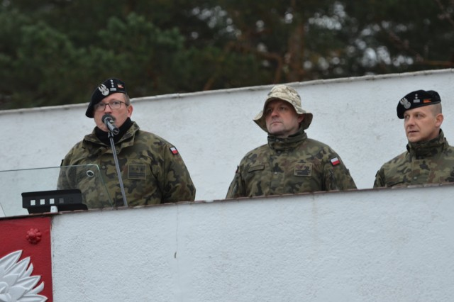 Col. Dariusz Parylak, commander, 10th Armored Cavalry Brigade, 11th Lubuska Armored Cavalry Division, speaks during a ceremony for the 5th Squadron, 4th Cavalry Regiment, and the 10th Armored Cavalry Brigade troops, at Red Square in Swietoszow, Poland, Oct. 23. The ceremony celebrates the growing partnership between the units and the countries. The 5th Squadron, 4th Cavalry Regiment, 2nd Armored Brigade Combat Team, 1st Infantry Division is in Europe to support Atlantic Resolve. Atlantic Resolve is a U.S. endeavor to fulfill NATO commitments by rotating U.S. -based units throughout the European theater and training with NATO Allies and partners. (U.S. Army photo by Sgt. Shiloh Capers)