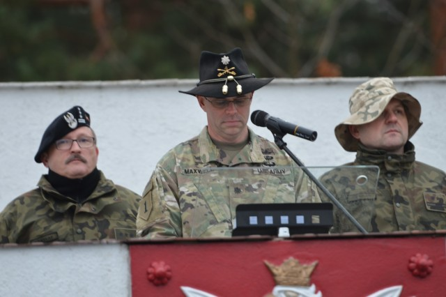 U.S. Army Trooper Lt. Col. Dave Maxwell, squadron commander, 5th Squadron, 4th Cavalry Regiment, 2nd Armored Brigade Combat Team, 1st Infantry Division, speaks during a ceremony for the 5th Squadron, 4th Cavalry Regiment, and the 10th Armored Cavalry Brigade, 11th Lubuska Armored Cavalry Division troops, at Red Square in Swietoszow, Poland, Oct. 23. The ceremony celebrates the growing partnership between the units and the countries. The 5th Squadron, 4th Cavalry Regiment is in Europe to support Atlantic Resolve. Atlantic Resolve is a U.S. endeavor to fulfill NATO commitments by rotating U.S. -based units throughout the European theater and training with NATO Allies and partners. (U.S. Army photo by Sgt. Shiloh Capers)