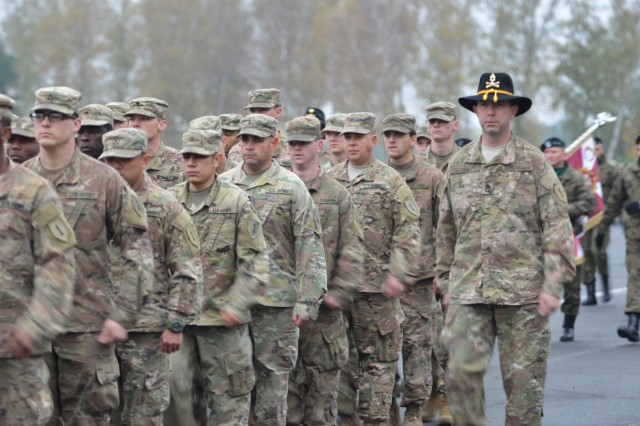 Soldiers from Delta Company, 299th Brigade Support Battalion, attached to 5th Squadron, 4th Cavalry Regiment, 2nd Armored Brigade Combat Team, 1st Infantry Division, march in a pass in review during a a ceremony, Red Square in Swietoszow, Poland, Oct. 23. The 5th Squadron, 4th Cavalry Regiment, participates in a ceremony with Polish soldiers from the 10th Armored Cavalry Brigade, 11th Lubuska Armored Cavalry Division, to celebrate the partnership between the U.S. and Poland. The 5th Squadron, 4th Cavalry Regiment, 2nd Armored Brigade Combat Team, is in Europe to support Atlantic Resolve. Atlantic Resolve is a U.S. endeavor to fulfill NATO commitments by rotating U.S. -based units throughout the European theater and training with NATO Allies and partners. (U.S. Army photo by Sgt. Shiloh Capers)