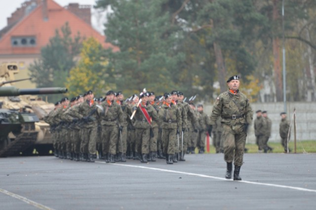 Polish soldiers from the 10th Armored Cavalry Brigade, 11th Lubuska Armored Cavalry Division, marches in a pass in review during a a ceremony, Red Square in Swietoszow, Poland, Oct. 23. The ceremony celebrates the partnership between  5th Squadron, 4th Cavalry Regiment, and the 10th Armored Cavalry Brigade. The 5th Squadron, 4th Cavalry Regiment, 2nd Armored Brigade Combat Team, is in Europe to support Atlantic Resolve. Atlantic Resolve is a U.S. endeavor to fulfill NATO commitments by rotating U.S. -based units throughout the European theater and training with NATO Allies and partners. (U.S. Army photo by Sgt. Shiloh Capers)