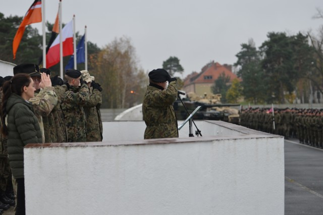 Col. Dariusz Parylak, commander, 10th Armored Cavalry Brigade, 11th Lubuska Armored Cavalry Division, oversees the pass in review during a ceremony, Red Square in Swietoszow, Poland, Oct. 23. The 10th Armored Cavalry Brigade and the 5th Squadron, 4th Cavalry Regiment, 2nd Armored Brigade Combat Team, 1st Infantry Division, participate in the ceremony to celebrate the growing friendship between the two units. The 5th Squadron, 4th Cavalry Regiment, 2nd Armored Brigade Combat Team, is in Europe to support Atlantic Resolve. Atlantic Resolve is a U.S. endeavor to fulfill NATO commitments by rotating U.S. -based units throughout the European theater and training with NATO Allies and partners. (U.S. Army photo by Sgt. Shiloh Capers)