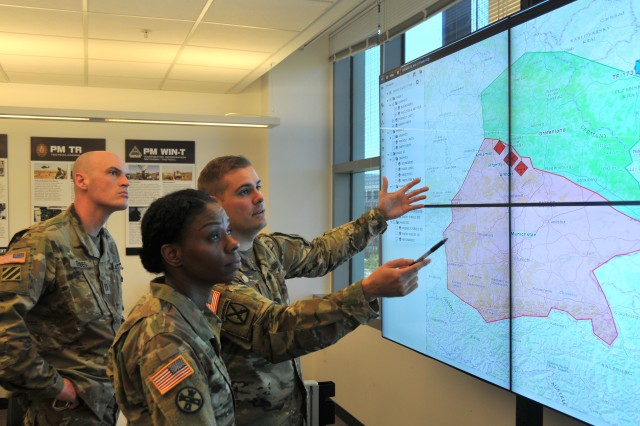 (From left) Capt. David Gerdes, Maj. Summer Favors and Capt. John (Mack) Turner demonstrate the Command Post Computing Environment prototype at Aberdeen Proving Ground, Maryland, on May 16, 2017.