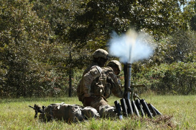 "Pfc. Zachary Ledesma, of Austin, Tx., and Spc. Tyreese McNeese, of Compton, Calif., both mortar men assigned to Company C ""Cold Steel"", 1st Battalion, 327th Infantry Regiment, fire a 60mm. mortar toward simulated enemy positions, Sept. 28, 2017, at Fort Campbell, Ky. Co. C, 1-327 Inf. Regt., conducted a company-level combined arms live-fire exercise to culminate several weeks of team, squad, platoon, and company training. (Photo by Staff Sgt. Todd Pouliot, 40th Public Affairs Detachment)"