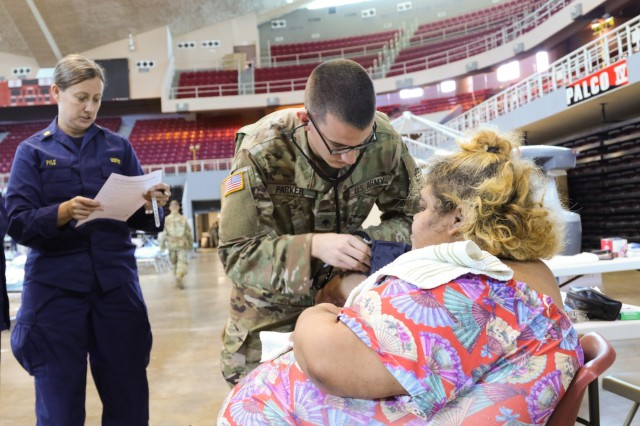 Spc. Jacob Parker, a healthcare specialist with the Ohio Army National Guard, conducts medical triage by taking a patient's vitals in the Auditorio Juan Pachín Vicéns, a repurposed basketball stadium, Oct. 20, 2017, in Ponce, Puerto Rico. The medical center operates in similar fashion to an urgent care, where patients are triaged and assessed, receive prescriptions and medications, and then discharged.