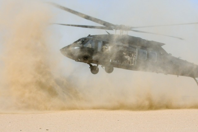 UDARI, Kuwait - A UH-60M Black Hawk from the 29th Combat Aviation Brigade's 1-147th Assault Helicopter Battalion, ferries both U.S. and Kuwaiti Forces during combined training in exercise Desert Wall at Camp Buehring, Kuwait, Oct. 4, 2017. Desert Wall consisted of air and ground assault training and tested the interoperability of the Kuwait Soldiers with their U.S. counterparts. (Photo by U.S. Army Staff Sgt. Isolda Reyes)
