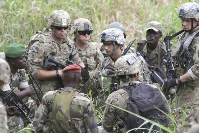 Second Lt. Michael A. Goss, center, a platoon leader in 101st Airborne Division (Air Assault)'s 327th Infantry Regiment, discusses squad-level tactics with Gabonese counterparts during Exercise Judicious Activation in Libreville, Gabon, July 27, 2017. U.S. Army Africa plans to boost its theater security cooperation activities across the continent, particularly in the Lake Chad Basin, this year to further support host nations.