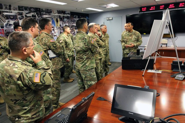 Army Chief of Staff Gen. Mark A. Milley (third from right) and senior cyber leaders listen to an update on Army cyber operations by Maj. Alex Bailey  of the Army Cyber Protection Brigade (right) at 780th Military Intelligence Brigade headquarters at Fort Meade, Md., Oct. 18.