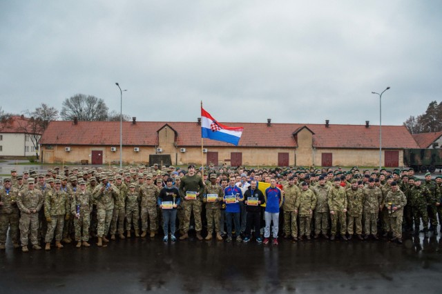 Soldiers from across the Battle Group Poland come together for an awards ceremony after the conclusion of a two-day celebration of Romanian Armed Forces Day, Oct. 25, 2017. Soldiers competed in sports ranging from tug-of-war and soccer to basketball and foot-tennis.