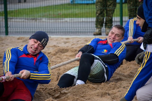 Soldiers from the Romanian Army participate in the tug-of-war competition as part of the Romanian Armed Forces Day celebration, Oct. 24, 2017.