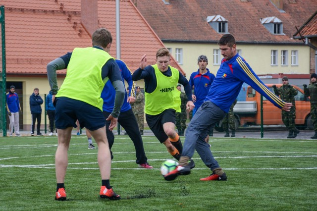 The Light Dragoons Element from the United Kingdom competes against the Romanian Army in the mini-soccer competition as part of the Romanian Armed Forces Day celebration, Oct. 24, 2017.