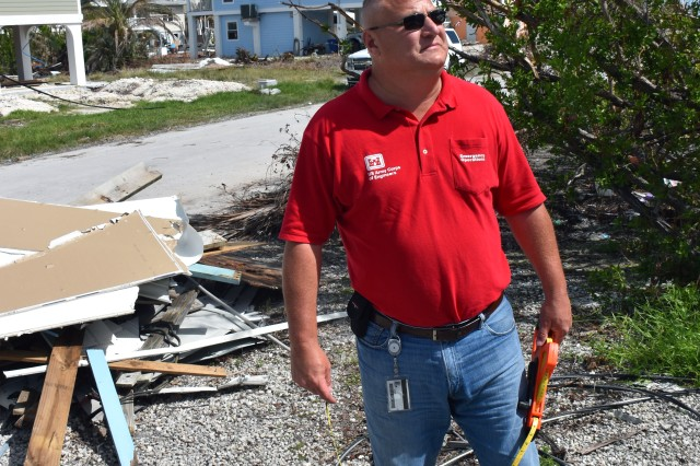 Ron Saunders, Huntington District accountant deployed as a housing quality assurance supervisor, conducts a site inspection at a home in Big Pine Key, Florida, Oct. 21. Saunders is a part of a 6-person housing team from the Corps of Engineers, Huntington District. The team is responsible for everything from Key West, Florida, to Key Largo.