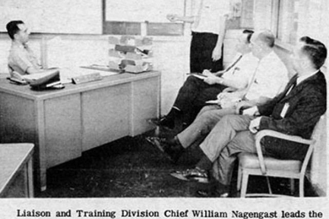 "In this scanned image from the October 1967 issue of ""The Detroit Arsenal News,"" Liaison and Training Division Chief William Nagengast leads the discussion at a staff meeting."