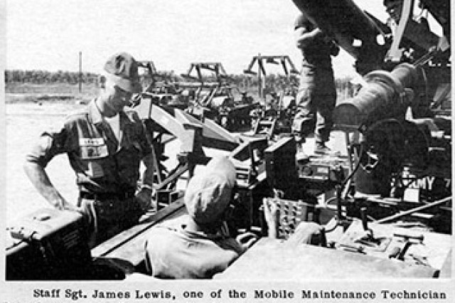 "In this scanned image from the October 1967 issue of ""The Detroit Arsenal News,"" one of the Mobile Maintenance Technician Branch NCOs provides maintenance instruction on the Hawk Missile Loader to personnel of a missile battery in Vietnam."