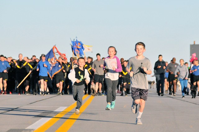 Soldiers and Family Members of 10th Combat Aviation Brigade, 10th Mountain Division (LI) participate in the World Run at Fort Drum on Oct. 20, which was coordinated simultaneously with 10th CAB units deployed around the world.